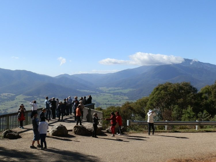 Tourists admiring Mt Bogong, highest mountain in Victoria