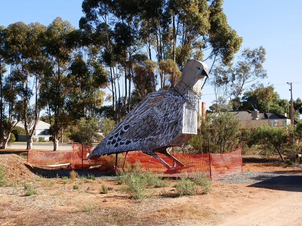 The Big Malleefowl against the backdrop of its home town, Patchewollock
