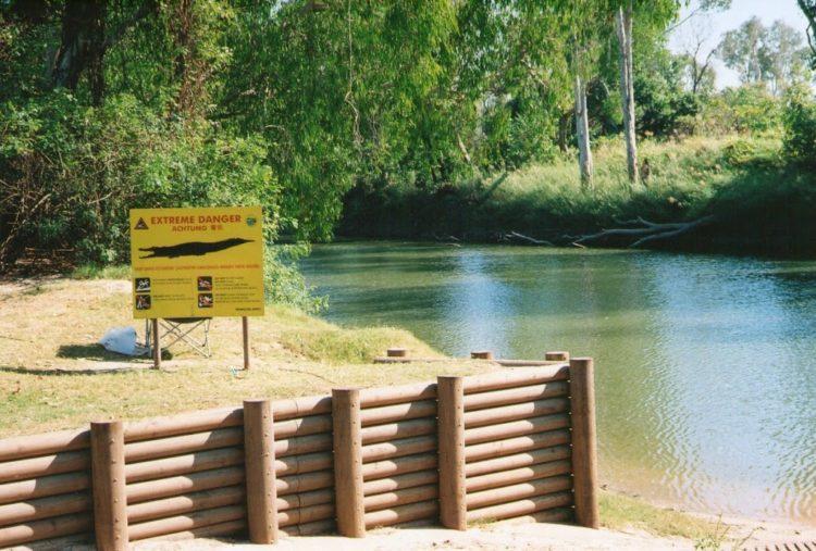 Crocodile warning sign, East Alligator River, Kakadu NP, Northern Territory
