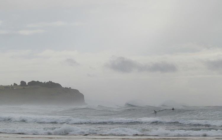 Sharpes Beach Surfers catch the waves, Ballina, New South Wales