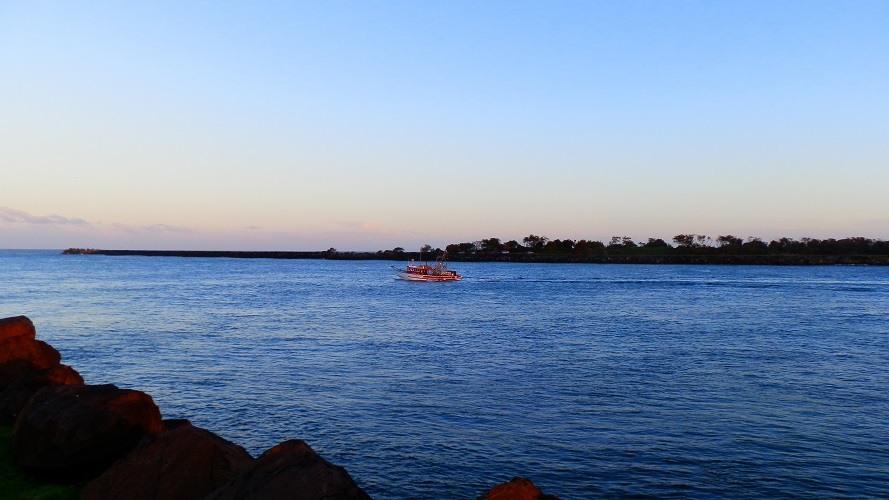 Prawn trawler heading down the Richmond River at Ballina, New South Wales