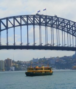 Climbers on Bridge Top with Ferry, Sydney