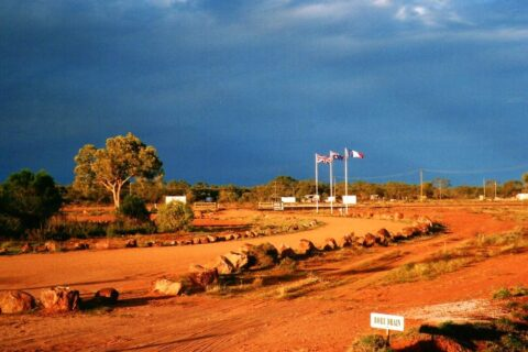 London, Paris, Thargomindah - Flags at the Thargomindah Hydro Station, Outback Queensland