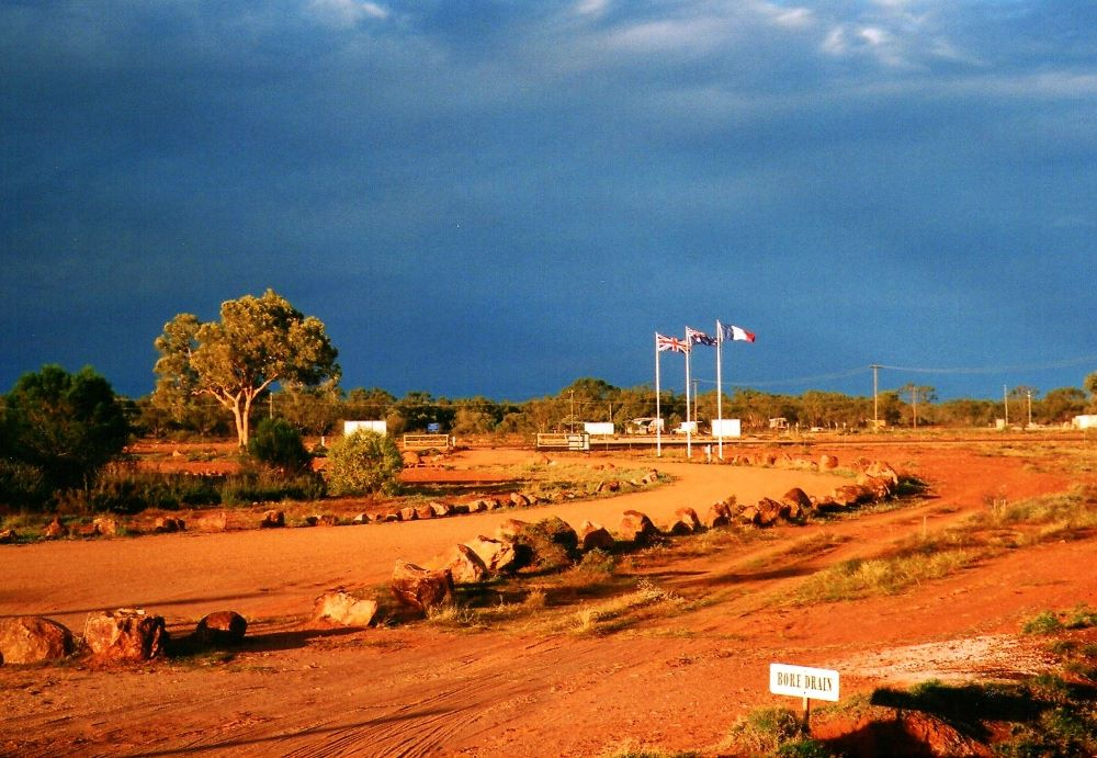 London, Paris, Thargomindah - Flags at the Thargomindah Hydro Power Plant, Outback Queensland
