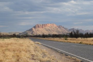 Storm clouds gather over the West MacDonnell Ranges via Alice Springs, Northern Territory