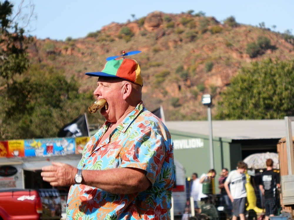Yes, that's a Cane Toad in his mouth!  Thommo at Kununurra Agricultural Show